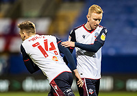 Bolton Wanderers' Tom White (left) replaces Ali Crawford <br /> <br /> Photographer Andrew Kearns/CameraSport<br /> <br /> The EFL Sky Bet League Two - Bolton Wanderers v Salford City - Friday 13th November 2020 - University of Bolton Stadium - Bolton<br /> <br /> World Copyright © 2020 CameraSport. All rights reserved. 43 Linden Ave. Countesthorpe. Leicester. England. LE8 5PG - Tel: +44 (0) 116 277 4147 - admin@camerasport.com - www.camerasport.com