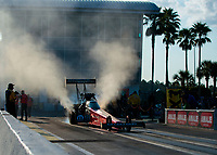 Sep 26, 2020; Gainesville, Florida, USA; NHRA top fuel driver Leah Pruett does a burnout during qualifying for the Gatornationals at Gainesville Raceway. Mandatory Credit: Mark J. Rebilas-USA TODAY Sports