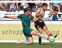 Saint Louis Athletica defender Kendall Fletcher (24) and FC Gold Pride midfielder Tina DiMartino (5) during a WPS match at Anheuser-Busch Soccer Park, in St. Louis, MO, July 26, 2009.  The match ended in a 1-1 tie.