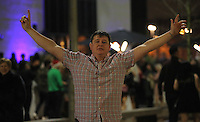 Pictured: A man raises his hands up in the air in joy in the early hours of Saturday, 17 December, 2016<br />