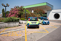"Milano, postazione car sharing ""e-vai"" alla stazione ferroviaria del quartiere Bovisa --- Milan, ""e vai"" car sharing at the railway station in Bovisa district"