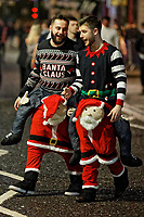Pictured: Two young men in Christmas onesies in Wind Street, Swansea, Wales, UK. Friday 20 December 2019<br /> Re: Black Eye Friday (also known as Black Friday, Mad Friday, Frantic Friday) the last Friday before Christmas, in Swansea, Wales, UK.