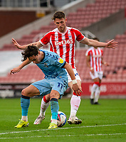 21st April 2021; Bet365 Stadium, Stoke, Staffordshire, England; English Football League Championship Football, Stoke City versus Coventry; Callum O'Hare of Coventry City holds off the pressure from  Jordan Thompson of Stoke City
