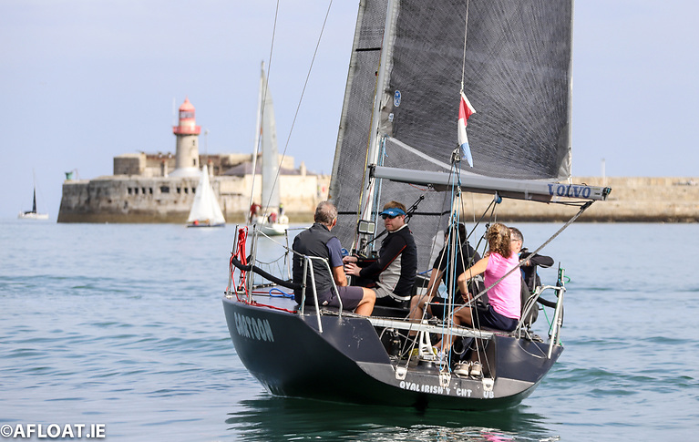 The all-black Quarter Tonner Cartoon, skippered by Sybil McCormack and Ken Lawless on her way out to a light airs DBSC race course from Dun Laoghaire Harbour