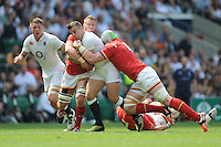 George Ford of England is tackled by Jake Ball and Dan Lydiate of Wales during the Old Mutual Wealth Cup match between England and Wales at Twickenham Stadium on Sunday 29th May 2016 (Photo: Rob Munro/Stewart Communications)