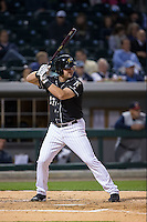 Dan Black (27) of the Charlotte Knights at bat against the Toledo Mud Hens at BB&T BallPark on April 27, 2015 in Charlotte, North Carolina.  The Knights defeated the Mud Hens 7-6 in 10 innings.   (Brian Westerholt/Four Seam Images)