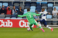 SAINT PAUL, MN - MAY 12: Tyler Miller #1 of Minnesota United FC and Deiber Caicedo #7 of Vancouver Whitecaps FC battle for the ball during a game between Vancouver Whitecaps and Minnesota United FC at Allianz Field on May 12, 2021 in Saint Paul, Minnesota.