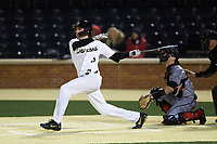 Wake Forest Demon Deacons pinch hitter Pierce Bennett (5) follows through on his swing against the Louisville Cardinals at David F. Couch Ballpark on March 7, 2020 in  Winston-Salem, North Carolina. The Demon Deacons defeated the Cardinals 3-2. (Brian Westerholt/Four Seam Images)