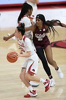 Arkansas guard Amber Ramirez (23) drives Thursday, Feb. 11, 2021, past Mississippi State forward Rickea Jackson (5) during the first half of play in Bud Walton Arena. Visit nwaonline.com/210212Daily/ for today's photo gallery. <br /> (NWA Democrat-Gazette/Andy Shupe)