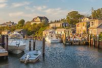 A view of boats docked in Menemsha Basin just before sunset, in the fishing village of Menemsha in Chilmark, Massachusetts on Martha's Vineyard.