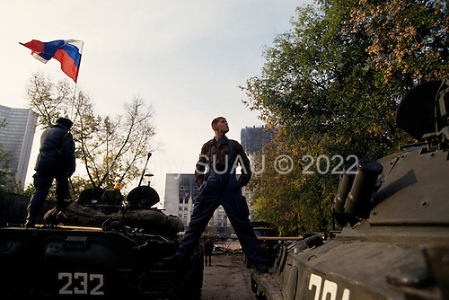 Moscow, Russia.October 5, 1993<br /> <br /> After a day of extreme violence Russian troops and tanks surround the Russia Parliament building. <br /> <br /> The preceding day saw Russian tanks and troops fire directly into the face of the building to dislodge hundreds of well armed anti-Yeltsin demonstrators held up inside. The demonstrators were either killed or arrested by the military. Numerous tank rounds were fired into the face of the building throughout the day with the upper floors catching fire and burning into the night..