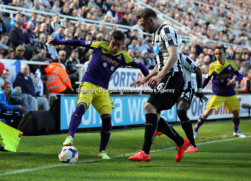 Pictured L-R: Pablo Hernandez of Swansea against Mathieu Debuchy of Newcastle. Saturday 19 April 2014<br /> Re: Barclay's Premier League, Newcastle United v Swansea City FC at St James Park, Newcastle, UK.