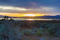 Near sunset, the western horizon glows and reflects in the Great Salt Lake, Utah.