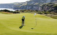 150719 | The 148th Open - Monday Practice<br /> <br /> Tiger Woods of USA putts on the 5th green during practice for the 148th Open Championship at Royal Portrush Golf Club, County Antrim, Northern Ireland. Photo by John Dickson - DICKSONDIGITAL