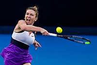 14th February 2021, Melbourne, Victoria, Australia; Simona Halep of Romania returns the ball during round 4 of the 2021 Australian Open on February 14 2020, at Melbourne Park in Melbourne, Australia.