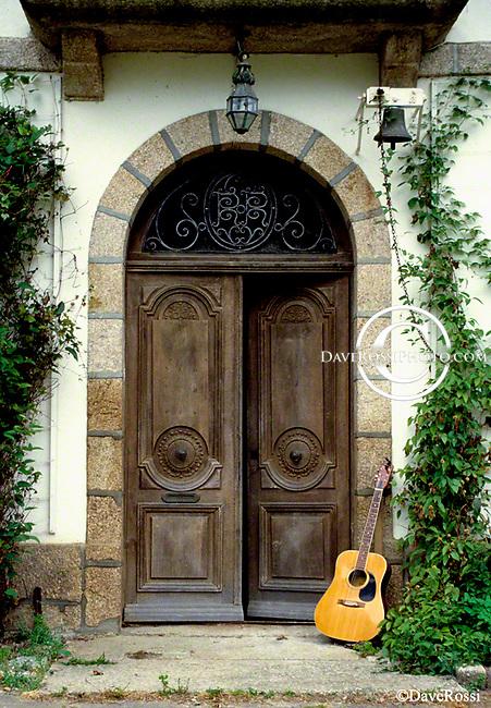 La Maison Blanche centuries old doors with guitar. Image taken in Dinan, Bretagne, France.