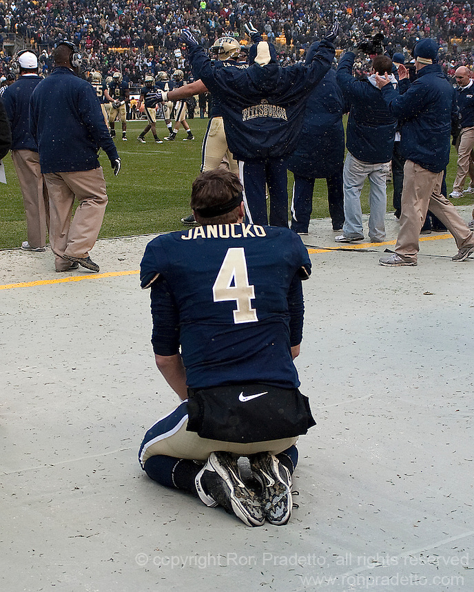 Pittsburgh holder Andrew Janocko kneels alone on the bench after fumbling the extra point snap from center. The Cincinnati Bearcats defeated the Pittsburgh Panthers 45-44 in the final seconds of the River City Rivalry in a contest for the Big East Championship and a major bowl bid on December 5, 2009 at Heinz Field, Pittsburgh, Pennsylvania. .