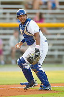 Catcher Edul Escobar #11 of the Burlington Royals looks to make a throw to first base against the Bristol White Sox at Burlington Athletic Stadium August 13, 2010, in Burlington, North Carolina.  Photo by Brian Westerholt / Four Seam Images
