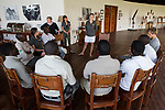 African Lion (Panthera leo) biologists, Caz Sanguinetti and Kim Young-Overton, giving presentation to tour guides, Kafue National Park, Zambia