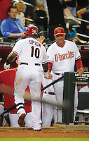 May 3, 2011; Phoenix, AZ, USA; Arizona Diamondbacks outfielder Justin Upton (left) is congratulated by manager Kirk Gibson after hitting a solo home run in the eighth inning against the Colorado Rockies at Chase Field. The Diamondbacks defeated the Rockies 4-3. Mandatory Credit: Mark J. Rebilas-