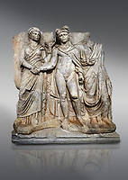 "Roman Sebasteion releif sculpture of emperor Claudius and Agrippina, Aphrodisias Museum, Aphrodisias, Turkey. <br /> <br /> Claudius in heroic nudity and military cloak shakes hands with his wife Agrippina and is crowned by the Roman people or the Senate wearing a toga. The subject is imperial concord with the traditional Roman state. Agrippina holds ears of wheat: like Demeter goddess of fertility. The emperor is crowned with an oak wreath, the Corona civica or ""citizen crow"", awarded to Roman leaders for saving citizens lives: the emperor id therefore represented as saviour of the people."