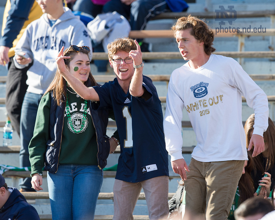 """Nov. 14, 2015; Sam O'Melveny (center) dances with friends before the game against Wake Forest. """"We showed up early to get a good seat for the Texas game and just started dancing,"""" he said, """"it kind of took on a life of its own."""" (Photo by Matt Cashore)"""
