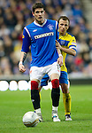 Rangers v St Johnstone...19.11.11   Scottish Premier League.Kyle Lafferty is closed down by Jody Morris.Picture by Graeme Hart..Copyright Perthshire Picture Agency.Tel: 01738 623350  Mobile: 07990 594431