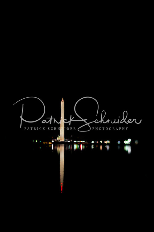 The Washington Monument is reflected in the national reflecting pool at night in Washington, DC. The Washington Monument is the most prominent structure, as well as one of the earlier attractions, in Washington, D.C. It was built in honor of George Washington, who led the country to independence and then became its first President. The Monument is shaped like an Egyptian obelisk, stands 555? 5 1/8? tall, and offers views in excess of thirty miles. It was finished on December 6, 1884.