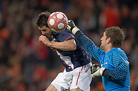 Carlos Bocanegra heads the ball in for a goal. .The USA men fell to the Netherlands 2-1 at Amsterdam ArenA, Wednesday, March 3, 2010.