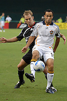 Los Angeles Galaxy forward Landon Donovan (10) shields the ball while covered from behind by DC United defender Bryan Namoff (26). DC United defeated the Los Angeles Galaxy 1-0 at RFK Stadium in Washington DC, Thursday August 9, 2007.