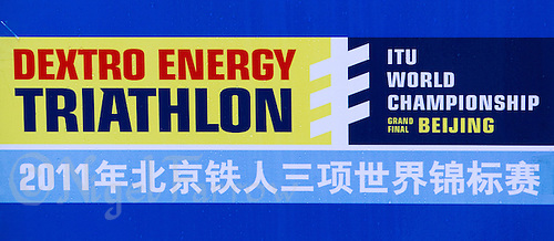 11 SEP 2011 - BEIJING, CHN - Multilingual event sign at the 2011 ITU World Age Group Olympic Distance Triathlon Championships .(PHOTO (C) NIGEL FARROW)