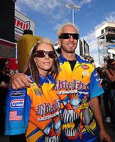 Nov. 2, 2008; Las Vegas, NV, USA: NHRA pro stock motorcycle rider Angie McBride (left) and her boyfriend Matt Smith during the Las Vegas Nationals at The Strip in Las Vegas. Mandatory Credit: Mark J. Rebilas-