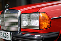 The headlight of the Mercedes W123 series 230TE estate version, outside the Penderyn Whisky Distillery in south Wales, UK. Tuesday 19 June 2018