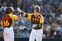 Chance Sisco of the USA Team is greeted by teammate Andrew Benintendi after hitting a home run against the World Team during The Futures Game at Petco Park on July 10, 2016 in San Diego, California. World Team defeated USA Team, 11-3. (Larry Goren/Four Seam Images)