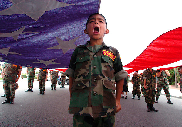 """O.parade.1.0702.jl.jpg/photo Jamie Scott Lytle/Ten year old Raymond Rodriguez of Camp Pendleton yells """"Yes Sir"""" when asked if he and the other Young Marines if they are ready to start marching in the 12th Annual Freedom Days parade held in Oceanside Saturday. The Young Marine youth group carries a giant American Flag every year in the annual event."""