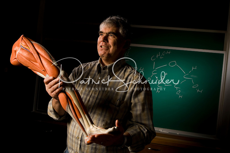 A college biology professor gives a lecture at a college in Belmont, NC.