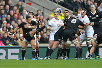 Aaron Smith of New Zealand is harassed by Lee Dickson of England as he sends up a box kick during the QBE Autumn International match between England and New Zealand at Twickenham on Saturday 16th November 2013 (Photo by Rob Munro)