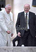 Pope Francis Domenico Giani personal bodyguard the Pope.during his weekly general audience in St. Peter square at the Vatican, Wednesday. September 24, 2014.