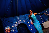 Enrique, a Salvadorean transvestite, performs at the Circo Brasilia, a family run circus travelling in Central America, 10 May 2011. The Circo Brasilia circus belongs to the old-fashioned traveling circuses with a usual mixture of acrobat, clown and comic acts. Due to the general loss of popularity caused by modern forms of entertainment such as movies, TV shows or internet, these small family enterprises balance on the edge of survival. Circuses were pushed away and now they have to set up their shows in more remote villages. The circus art and culture is slowly dying in Latin America.