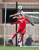 Tommy Muller (8) of Georgetown has the ball tackled away from him by Andres Vargas (9) of St. John's during the game at North Kehoe Field in Washington DC. Georgetown defeated St. John's, 2-1, in the Big East conference tournament quarterfinals.