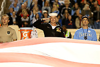 CHAPEL HILL, NC - NOVEMBER 02: On Military Appreciation Day, active and retired members of the military help hold the flag during the national anthem during a game between University of Virginia and University of North Carolina at Kenan Memorial Stadium on November 02, 2019 in Chapel Hill, North Carolina.