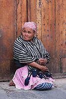Antigua, Guatemala.  Maya woman Sitting, Plaza de Armas.  Semana Santa.