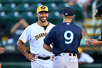 Bradenton Marauders manager Jonathan Johnston (19) during the lineup exchange with Ryan Hunt (9) before Game Two of the Low-A Southeast Championship Series against the Tampa Tarpons on September 22, 2021 at LECOM Park in Bradenton, Florida.  (Mike Janes/Four Seam Images)