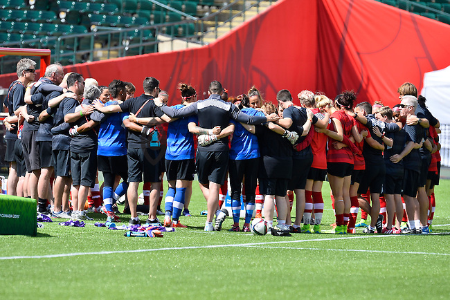 Members of Canada's team in a huddle before practice on the eve of inaugural Women's World Cup Soccer match, Thursday June 04, 2015 in Edmonton, Alberta. (Mo Khursheed/TFV Media via AP Images)