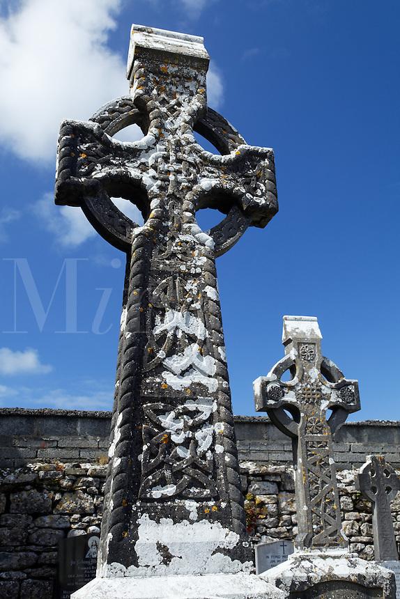 Stone crosses in graveyard at Kilfenora Cathedral, Kilfenora, The Burren, County Clare, Republic of Ireland