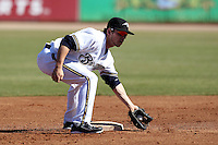 Peoria Javelinas second baseman Scooter Gennett #58 during an Arizona Fall League game against the Salt River Rafters at Peoria Sports Complex on November 2, 2011 in Peoria, Arizona.  Peoria defeated Salt River 4-2.  (Mike Janes/Four Seam Images)