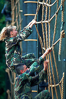 Male and female recruits on a training confidence course. San Antonio, Texas.