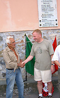 BNPS.co.uk (01202 558833)<br /> Pic: HannBooks/BNPS<br /> <br /> PICTURED: Author Robert Hann meeting one of the brave Partisan's, Lino Moggia who helped his father.<br /> <br /> Remarkable photos taken deep behind enemy lines by an SAS unit during a daring wartime operation have come to light on the 75th anniversary of the mission. <br />  <br /> The little-known Operation Galia on the 27th December 1944 involved just 33 SAS men hoodwinking the Nazis and their fascist allies into thinking a much greater force had landed behind them in Italy in December 1944.<br />  <br /> Adolf Hitler's forces had just launched a major surprise offensive in the Ardennes Forest in Belgium that became known as the Battle of the Bulge.<br /> <br /> Robert Hann, whose late father was SAS Paratrooper Stanley Hann, retraced his father's wartime experiences and part of his [father's] epic 80 mile long escape route through the Apennine mountains which the men took, to help him write the book 'SAS Operation Galia.'