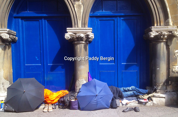 2 People sleeping on the steps of a church in Leonard Street in Shoreditch, London.<br /> <br /> Stock Photo by Paddy Bergin