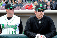 Dayton Dragons pitchers Joel Bender #19 and Mo Wiley #33 in the dugout before a game against the Bowling Green Hot Rods on April 20, 2013 at Fifth Third Field in Dayton, Ohio.  Dayton defeated Bowling Green 6-3.  (Mike Janes/Four Seam Images)